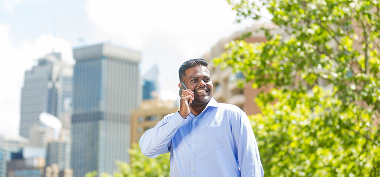 International student on the phone in Sydney