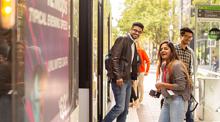 Students at tram stop in Melbourne