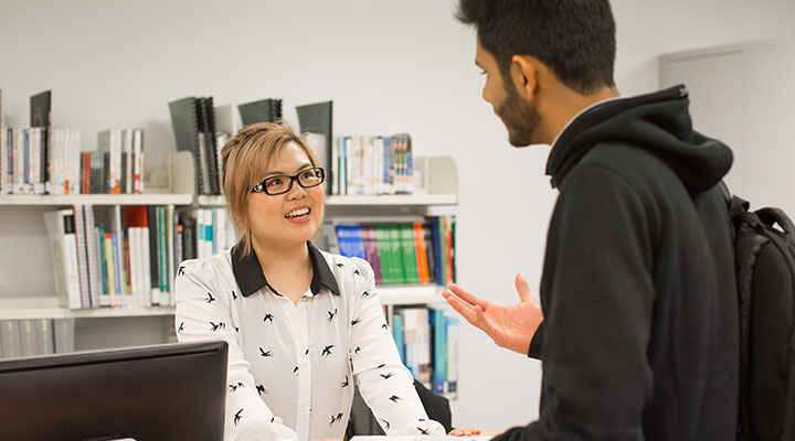 Receptionist helping student at the Study Centres